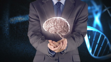 Businessman presenting brain with hands
