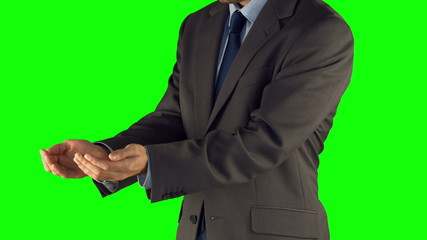 Businessman presenting with hands