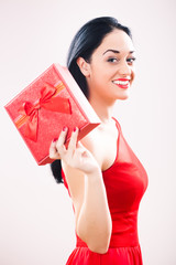 Happy girl holding gift box