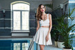 Beautiful sexy woman catalog summer collection clothes pool