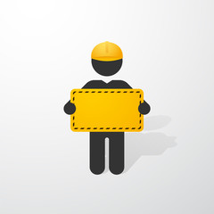 black figure with yellow helmet and a sign construction
