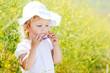 toddler girl in field