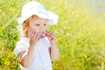 toddler girl in field