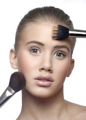 Make-up girl, woman teenager face with make up brushes