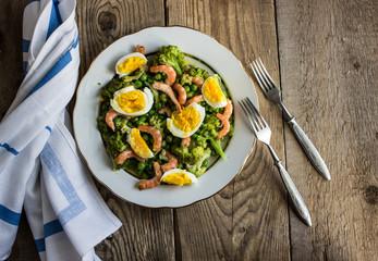 healthy food. salad with broccoli, peas, shrimps and eggs