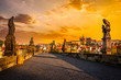 Leinwanddruck Bild - Charles bridge and Prague castleon sunrise