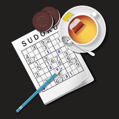 top view of Sudoku game, mug of tea and chocolate cookies