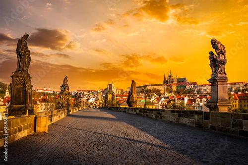 Leinwanddruck Bild Charles bridge and Prague castleon sunrise