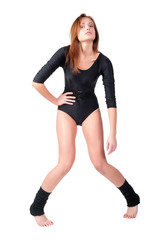 Young cute woman in gymnast suit. Isolated over white background