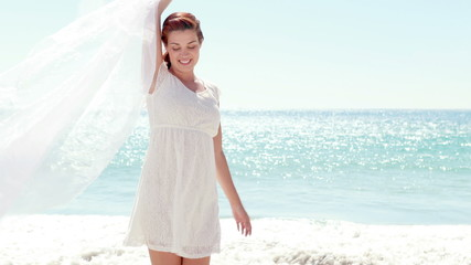 Woman in white dress on the beach
