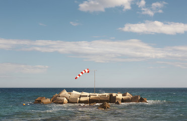 Wind indicator in mediterranean coastline. Alicante, Spain