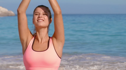 Happy fit woman doing yoga
