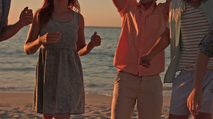 Happy friend dancing at the beach