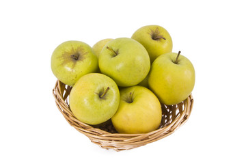 wicker basket with green apples