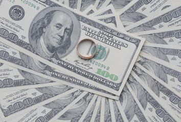 gold ring on the dollar