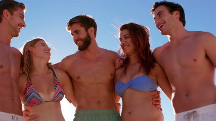 Attractive friends standing together at the beach