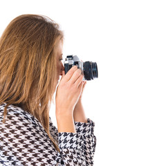Woman photographing over white background