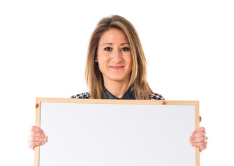 Woman holding empty placard