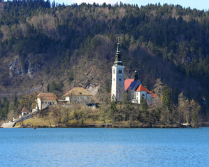 church with a high Bell Tower on the island on Lake Bled in Slov
