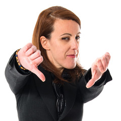 Business woman doing bad signal