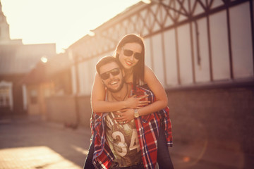 Happy man giving piggyback ride to girlfriend
