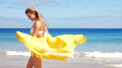 Beautiful blonde walking on the beach