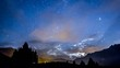 night sky stars moon fast clouds on mountain background Moonrise