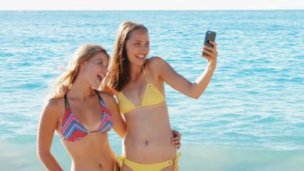 Friends taking selfie on the beach