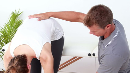 Physiotherapist checking patients flexibility