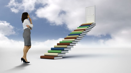 Businesswoman looking at steps made of books in the cloudy sky