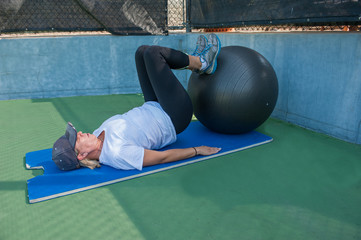 Supine leg curl exercise on stability ball