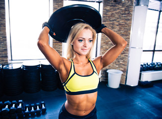 Beautiful fit woman workout at crossfit gym