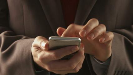 Businessman using his smartphone