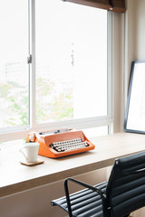 Retro old typewriter on wooden table