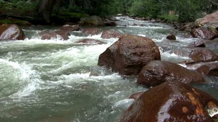 (Seamless Loop) Flowing Water Over Big Boulders