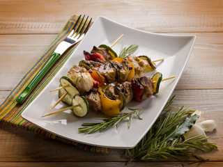 skewer with meat zucchinis and capsicum