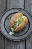 Baked potato toped with cottage cheese and chives.