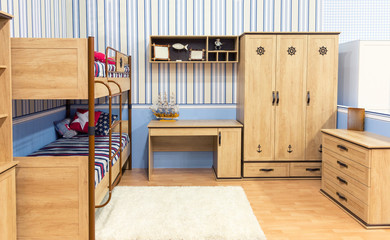 Bright bedroom with a bed cupboard and table