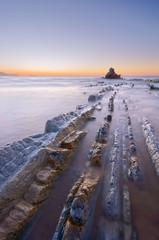 rocks with silky water in Sopelana beach