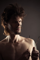 portrait of man with two burnt wires