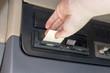 Leinwandbild Motiv Truck driver is using the tachograph card