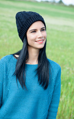 Relaxing young woman with wool cap