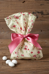 Fabric pouch wedding favor on old wooden table