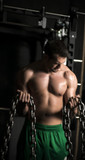 Muscular Man with Chains - 81612660