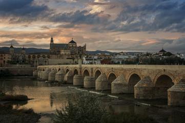 Cordoba roman bridge and Cathedral at sunset
