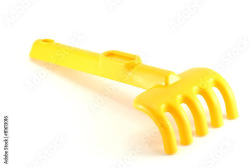 Yellow rake isolated on white background