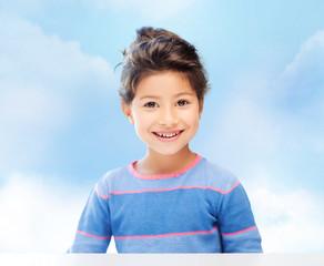 little girl over blue sky background