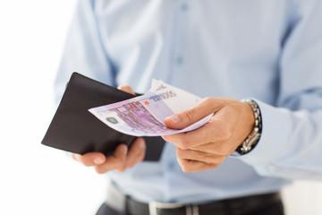 close up of businessman hands holding money