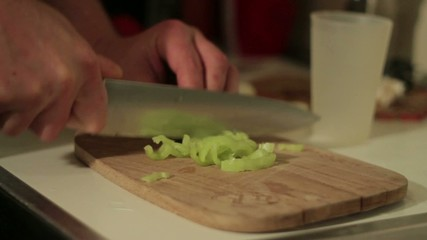 Man Cutting Green Peppers