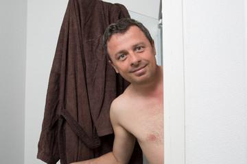Man in his bathroom smiling